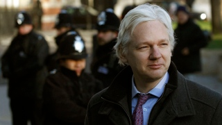 Wikileaks founder Julian Assange arrives at the Supreme Court in Westminste